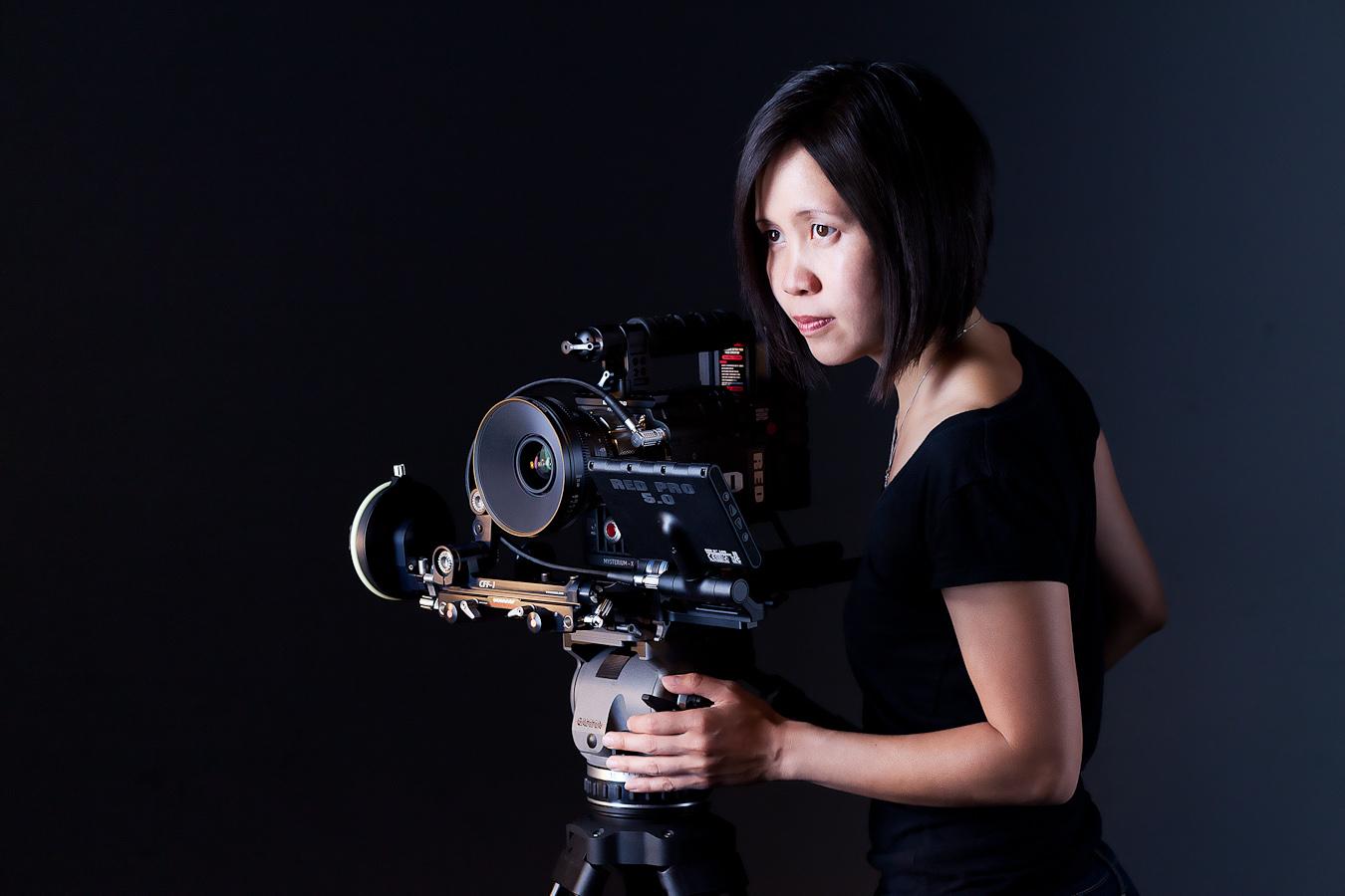 Iris Ng with a camera.