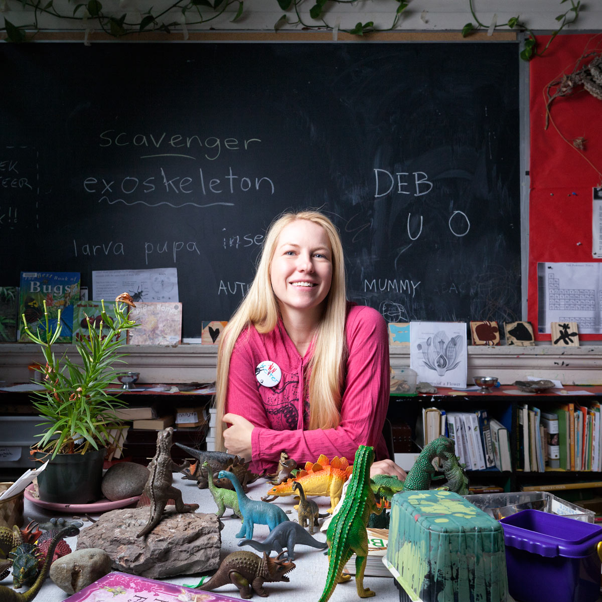 Kether Graham sits in a classroom at Alpha Alternative School