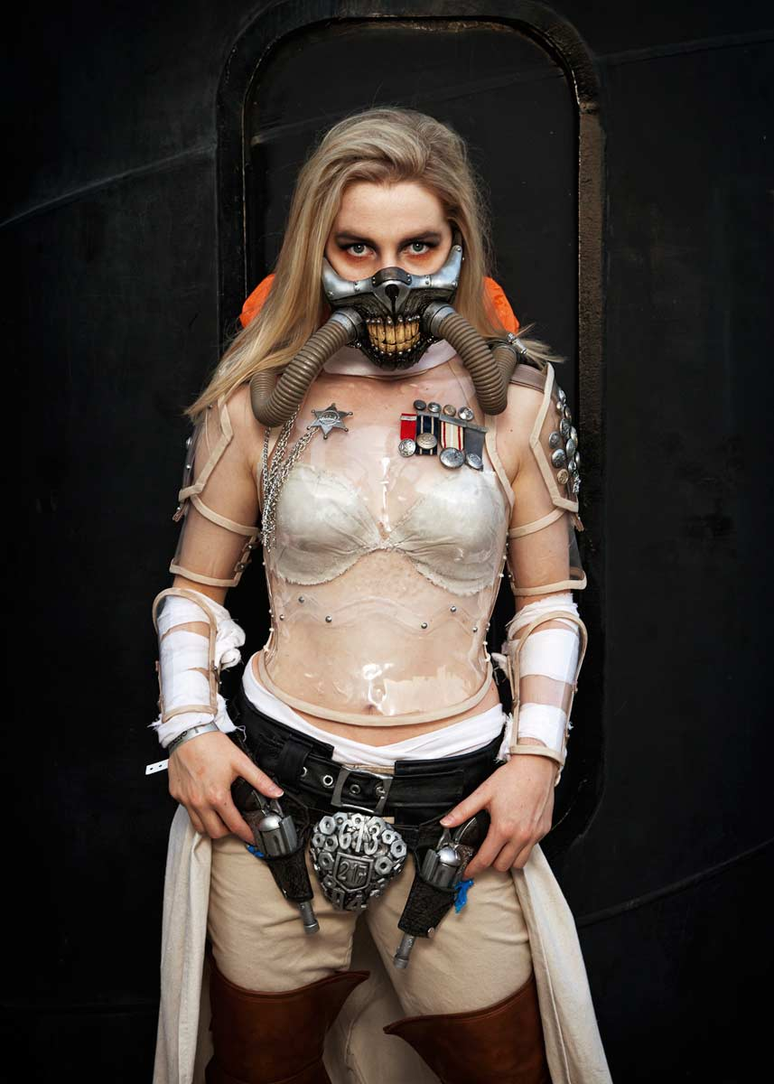 Female Mad Max Crossplayer dressed as Immortan Joe