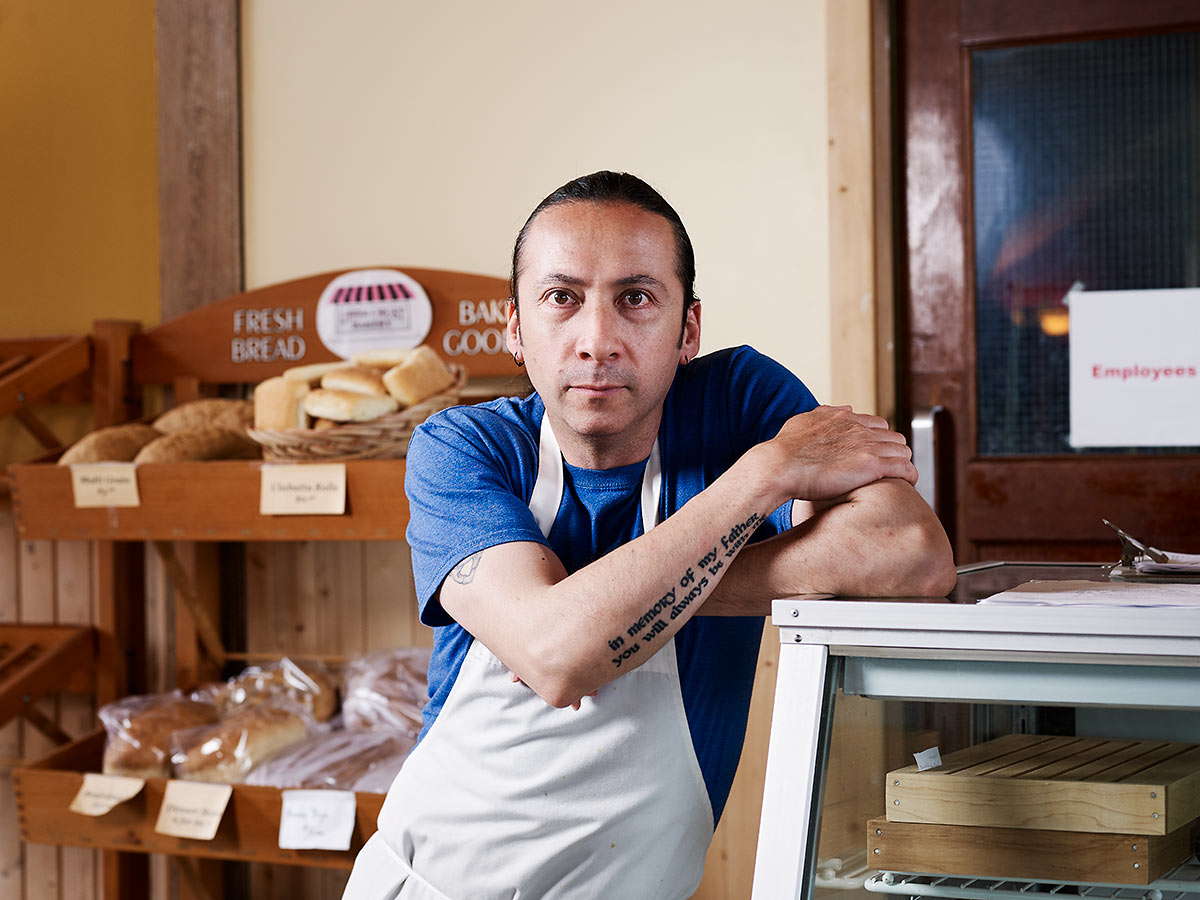 Chilean baker, actor, and martial artist Victor Reyes at the Upper Crust Bakery in Sointula, British Columbia