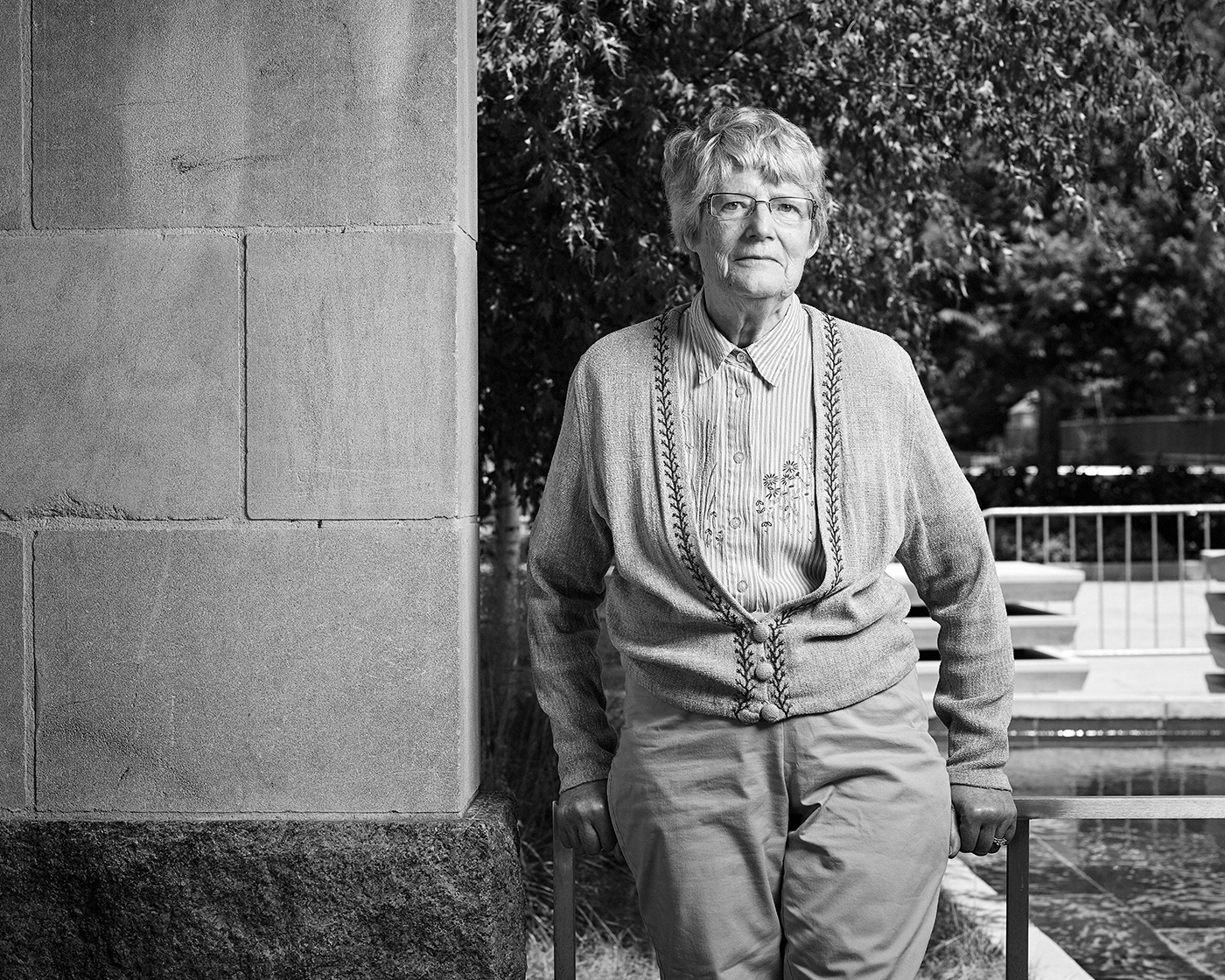 Portrait of Barbara Birkett standing in the Peace Garden at Nathan Phillips Square in Toronto.