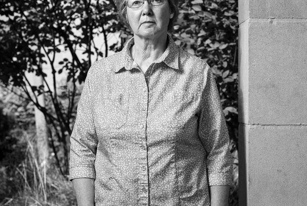 Portrait of Rosemary Keenan standing in the Peace Garden at Nathan Phillips Square in Toronto.