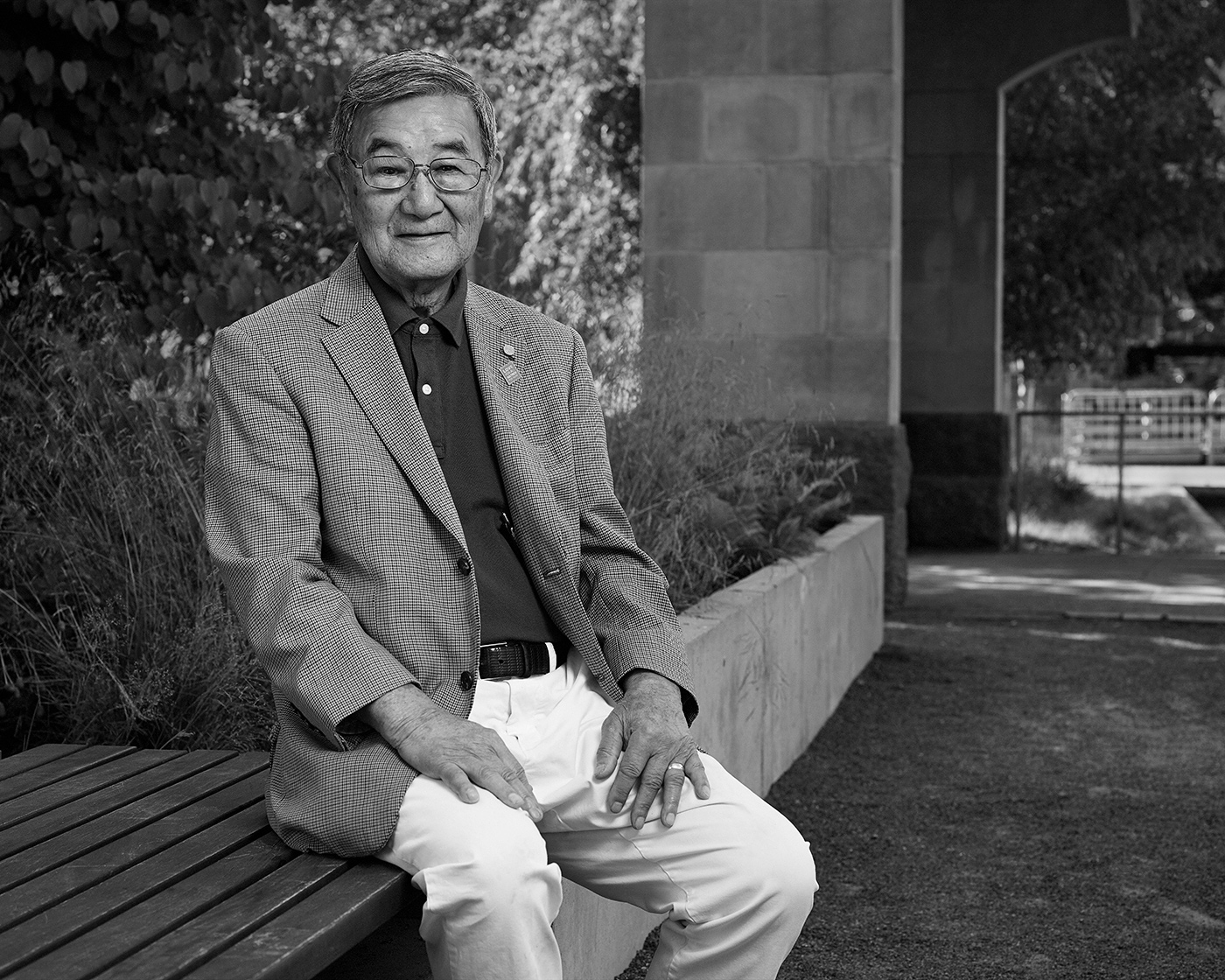Portrait of Sid Ikeda in the Peace Garden at Nathan Phillips Square in Toronto.