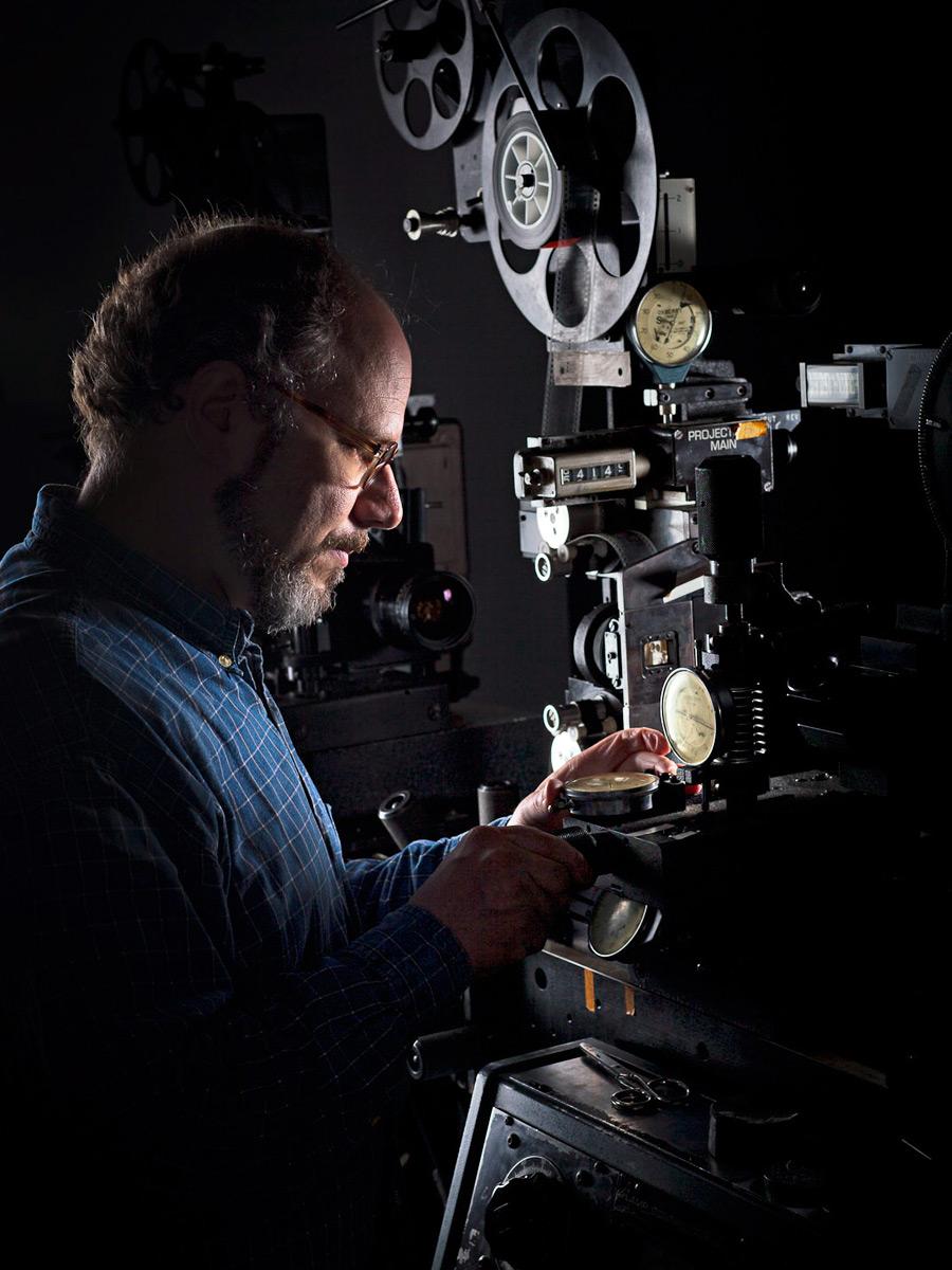Chris Gehman operates an optical printer.