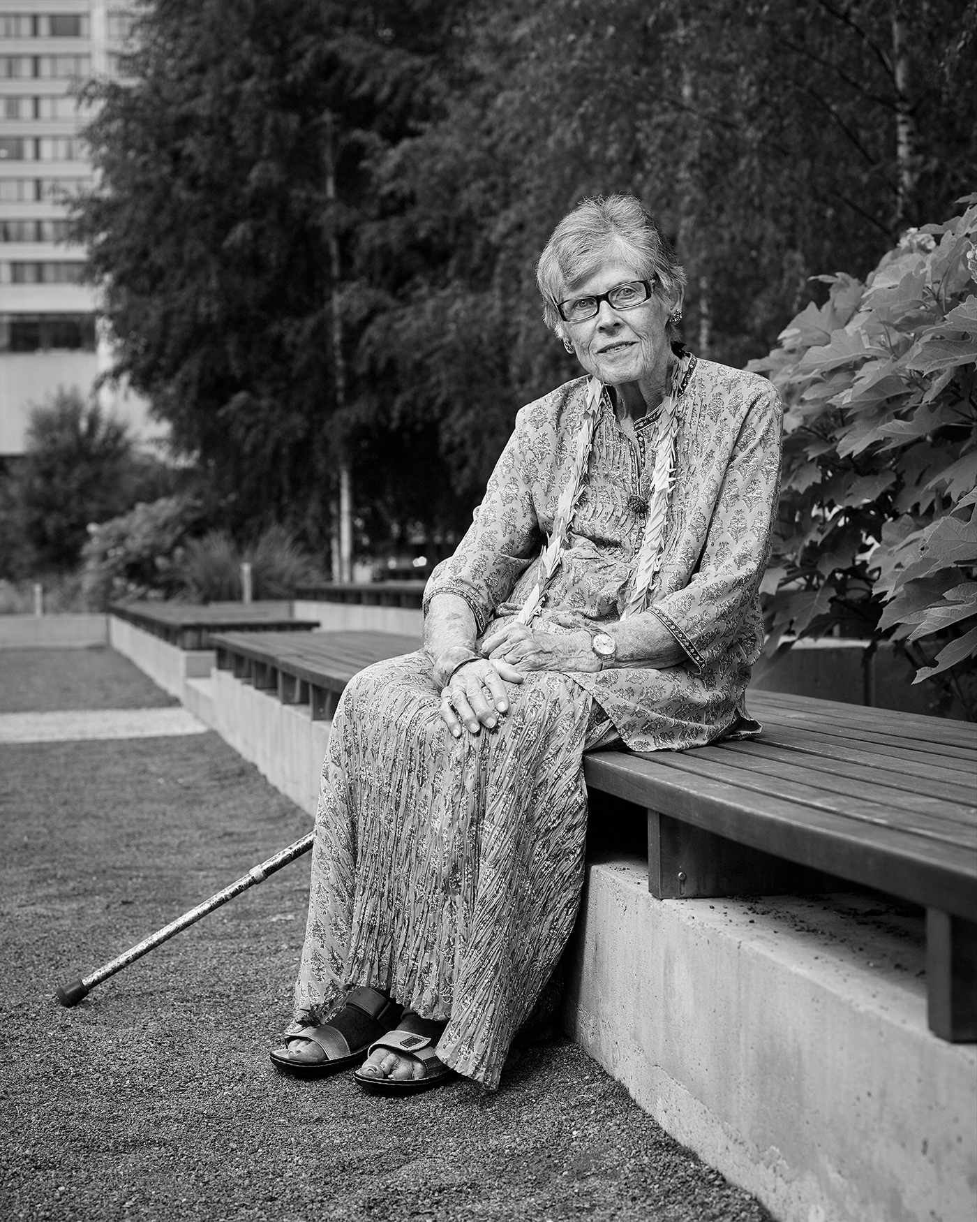 Portrait of Phyllis Manning Creighton sitting in the Peace Garden at Nathan Phillips Square in Toronto.