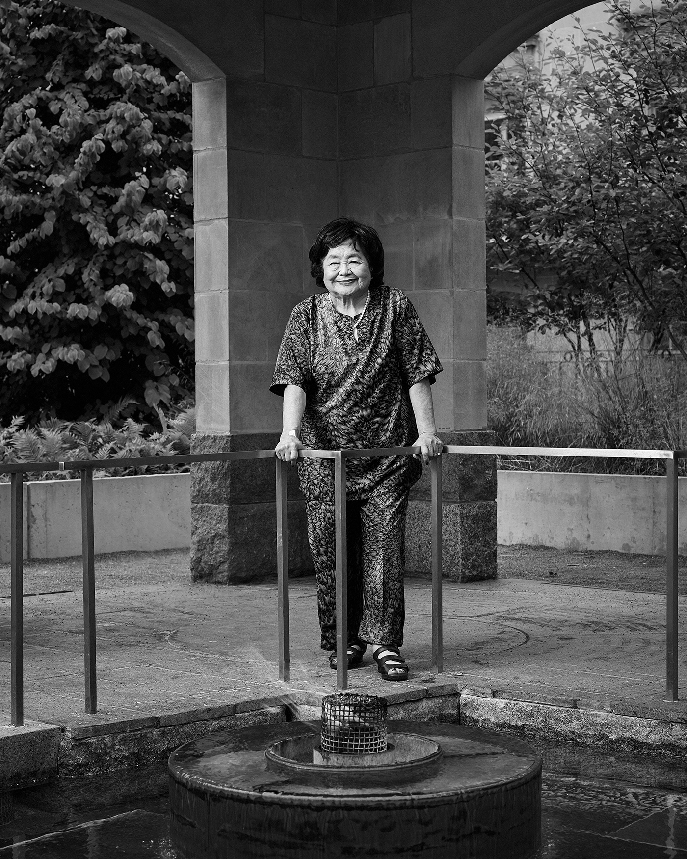 Portrait of Setsuko Thurlow standing by the Eternal Flame in the Peace Garden at Nathan Phillips Square in Toronto.